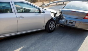 Two cars in collision on roadway
